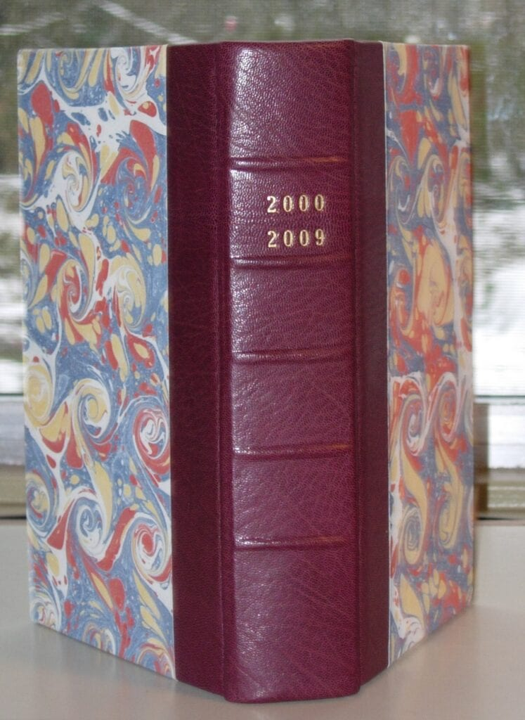 leather spine boards covered with marbeled paper