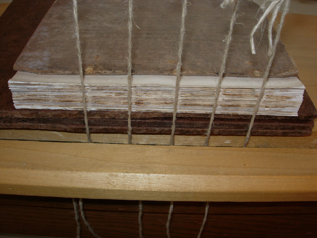 mended text block and prepared sewing frame