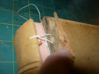 joint tackets thread is first pulled through shoulder then laced into board