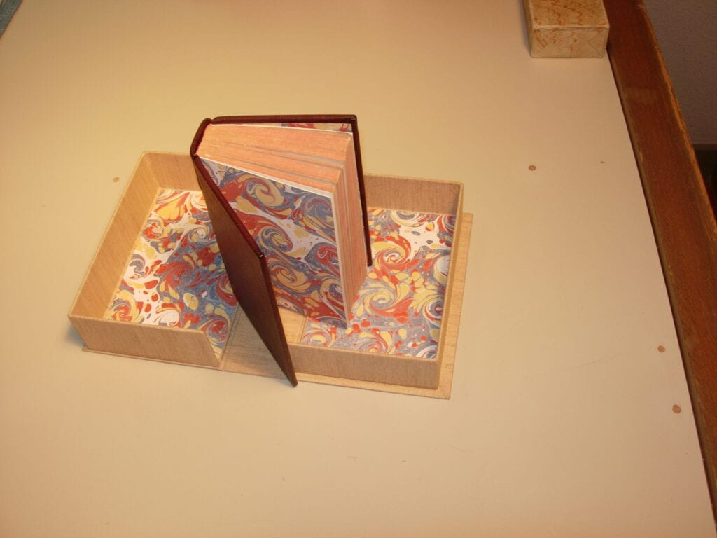 cloth bound book rebound in leather with custom box
