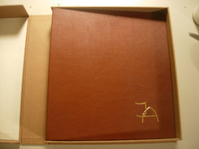 wedding album in box, die with initials of couple gold stamped onto cover